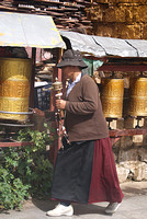 woman turning prayer wheels